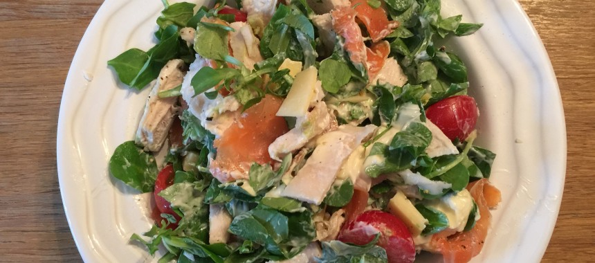 Chicken, salmon, cheese and avocado salad